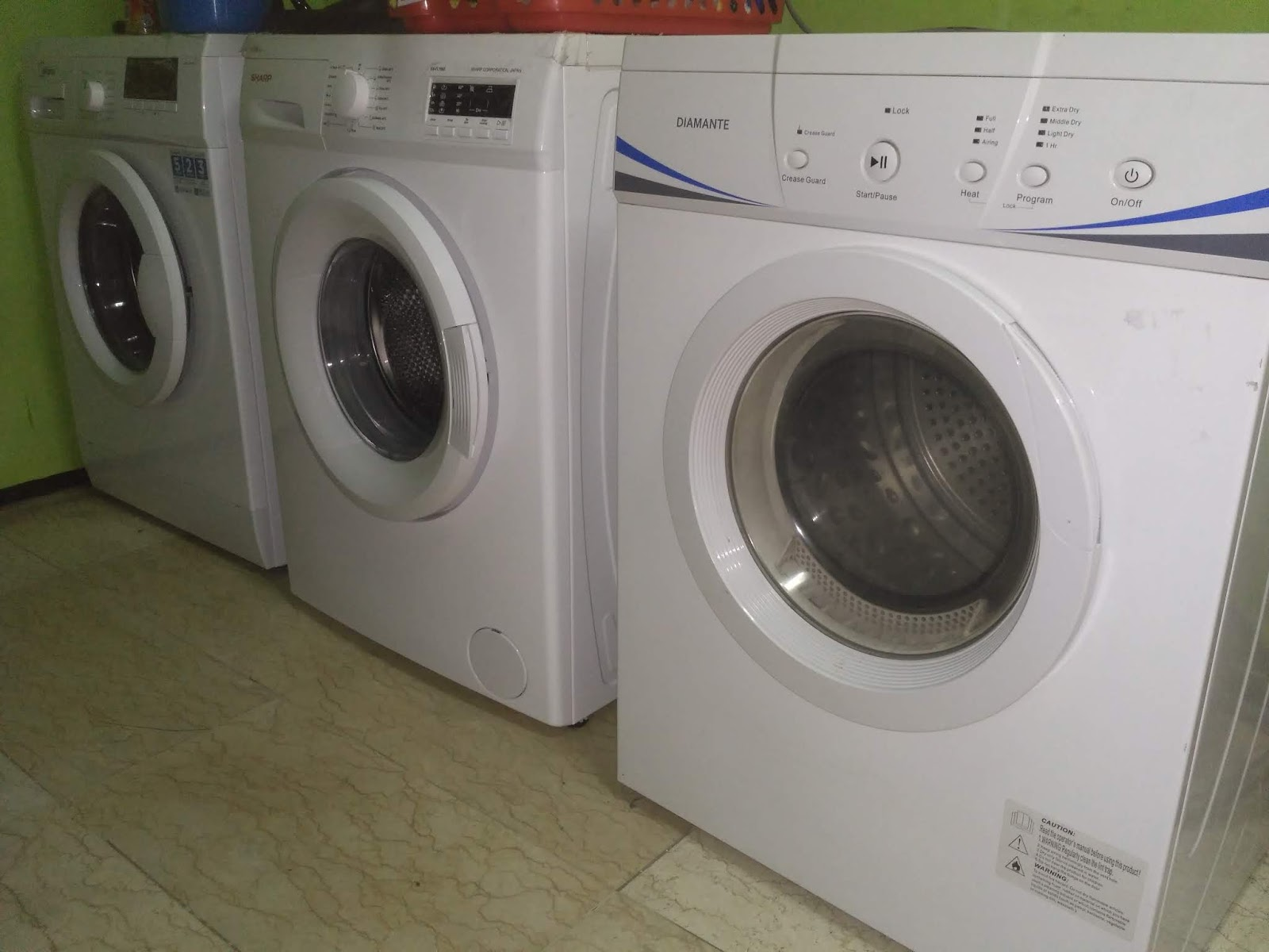 service mesin cuci front loading pamulang